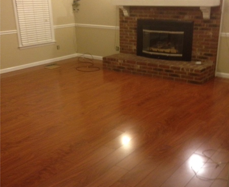 Artisan living spaces llc plank laminate or wood for Best flooring for resale value